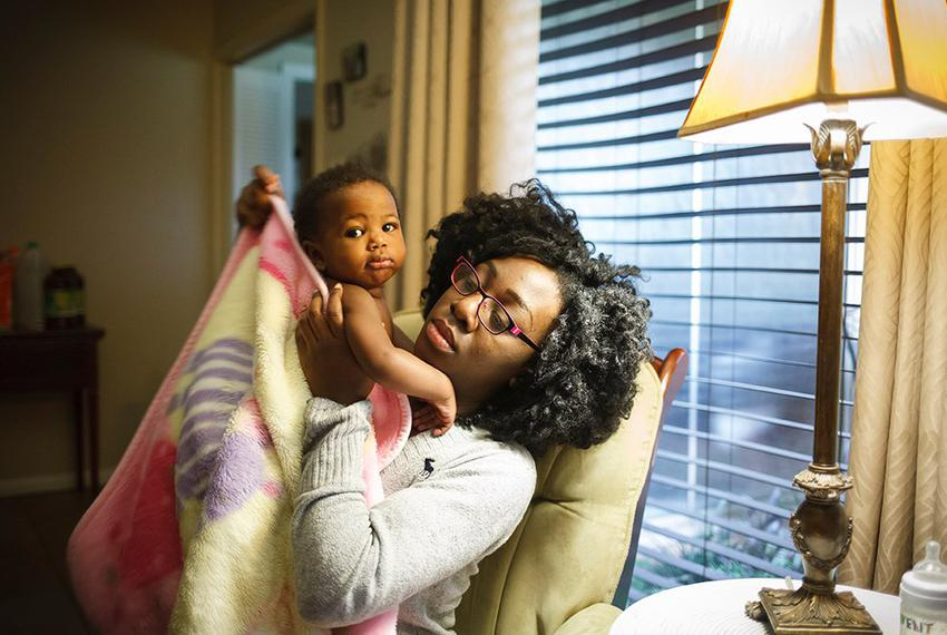 Jasmine Johnson, with 10-month-old daughter Rain, lost her Medicaid coverage and was told she could not re-enroll, even thou…