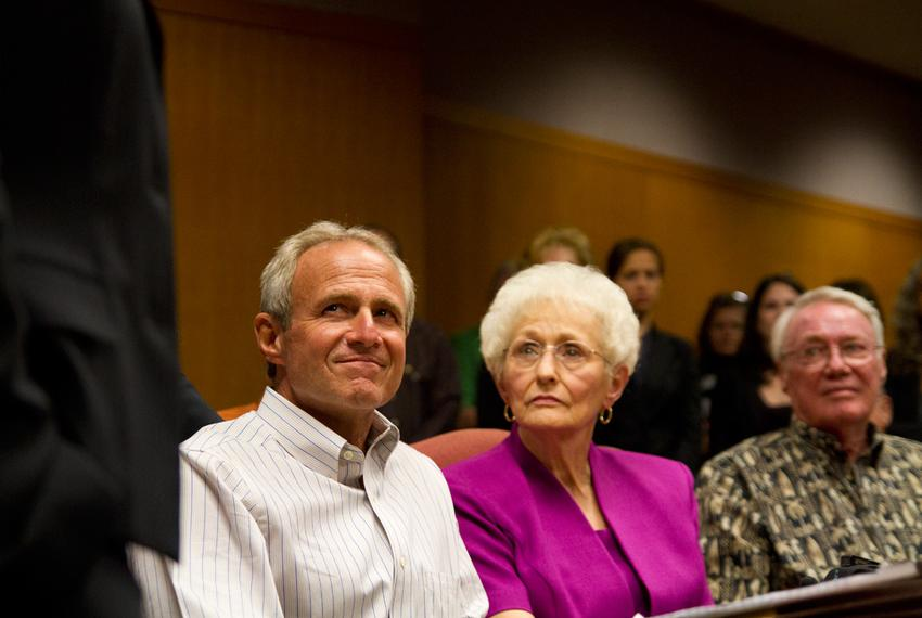 Michael Morton sits beside his mother, Patricia Morton, during an emotional press conference after a judge agreed to release…