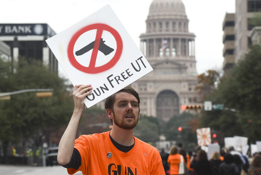 Anti-gun protester Mark Sheridan leads a group of 250 members of the Modern Language Association-sponsored rally against campus carry on Jan. 8, 2016.