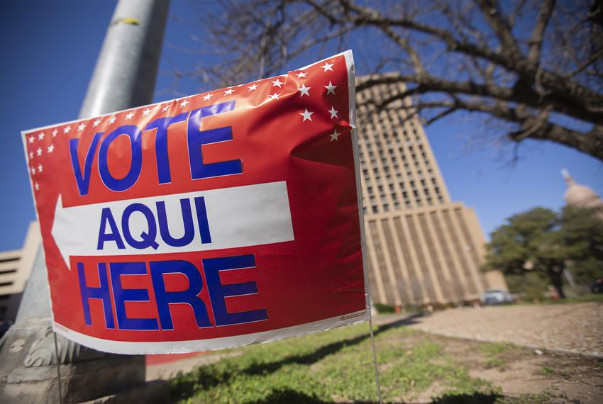 A voting sign near the Capitol in Austin on Feb. 26, 2020.