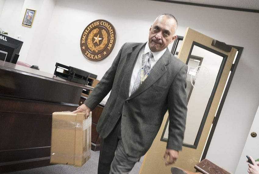 A Deptartment of Public Safety officer takes a box of records from the offices of the Texas Facilities Commission on Jan. 25, 2018 after the agency's board voted to oust Executive Director Harvey Hilderbran during Thursday's meeting. Hilderbran, a former state representative, had been at the commission since 2015.