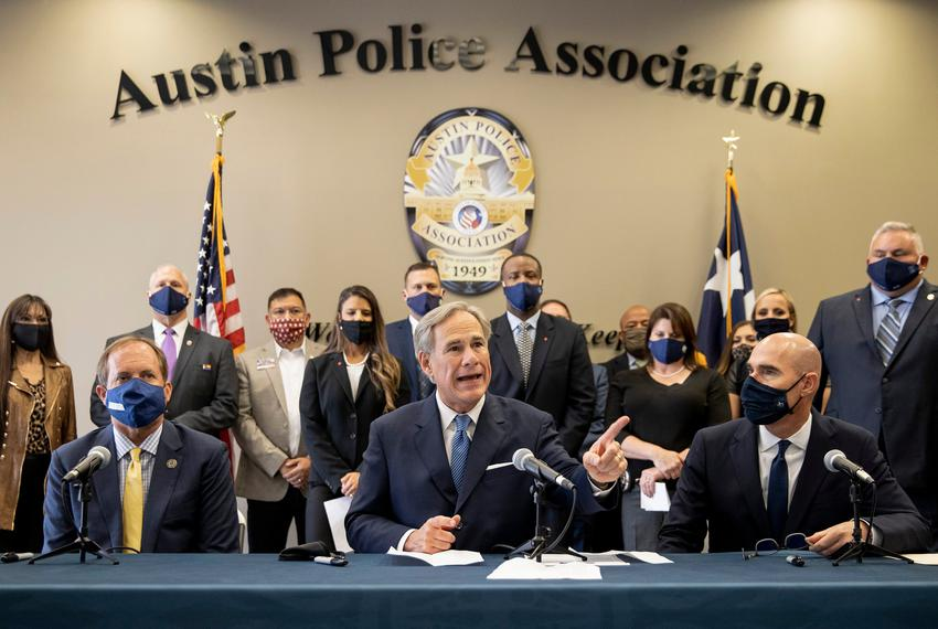 Gov. Greg Abbott speaks at a news conference with Texas Attorney General Ken Paxton, left, and Speaker Dennis Bonnen before …