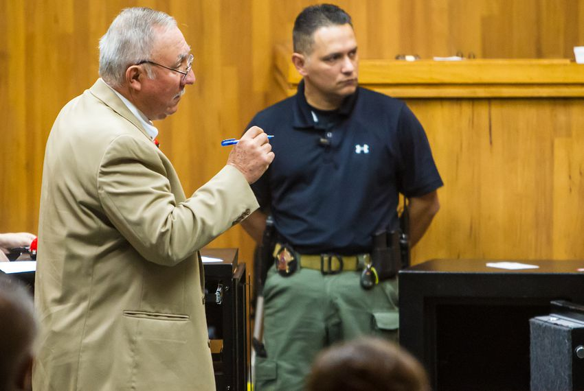 Chief Prosecutor Gus Garza walks by a safe brought into the courtroom as evidence during the murder trial of former Border Patrol agent Joel Luna and his brother Eduardo Luna Rodriguez.
