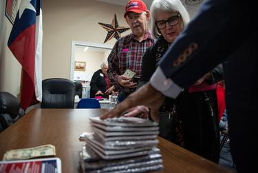 Danny Randolph waits in line to purchase his copy of KCarl Smith's engagement strategy book for 15 dollars after listening to the speaker at a Black Voices for Trump event, a nationwide initiative to sway voters, at the McLennan County Republican Headquarters in Waco on Feb. 26, 2020.