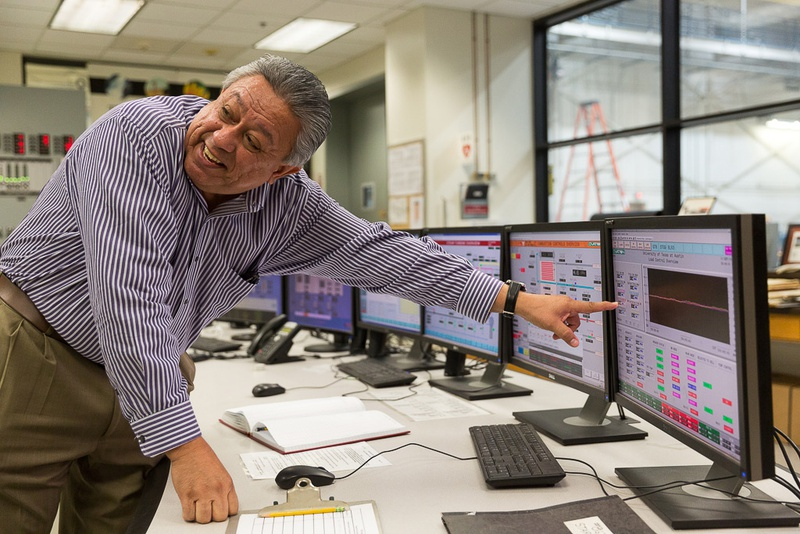 Juan Ontiveros manages the University of Texas at Austin's energy system, which generates electricity, heating and cooling for the entire campus — independent of the state's electricity grid. The campus burns less fuel than it did 40 years ago, a time when it enrolled thousands fewer students.