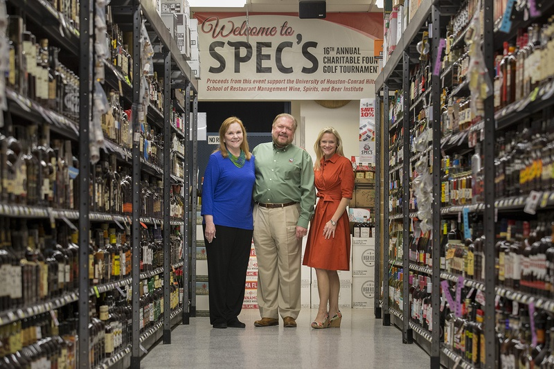 Spec's Liquor President John Rydman, with wife and owner Lindy Rydman in blue and their daughter Lisa Rydman, granddaughter of the chain's founder, at the flagship store in Houston on June 29, 2017. Spec's got the green light to begin expanding again after an administrative court poured cold water on sanctions sought by state liquor regulators.