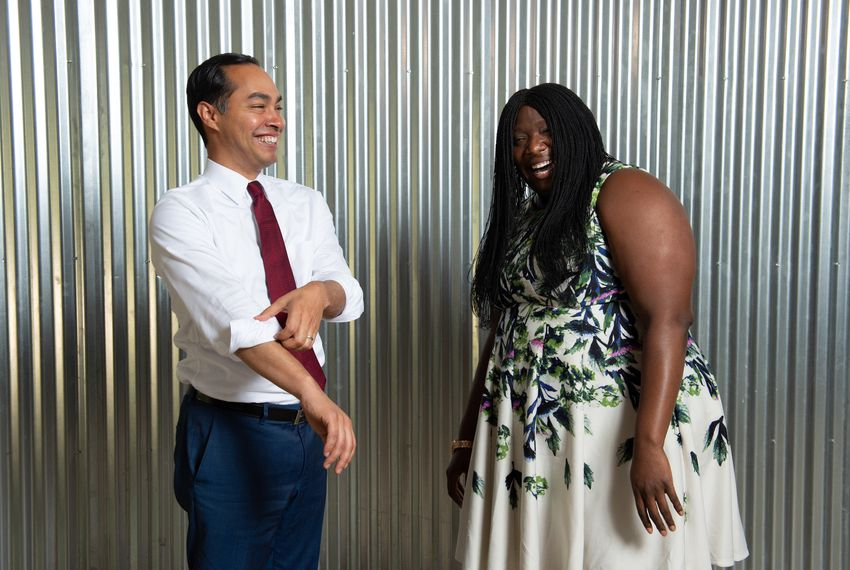 Maya Rupert, campaign manager for Julian Castro, and the candidate share a laugh during a photoshoot at the campaign's San Antonio office.