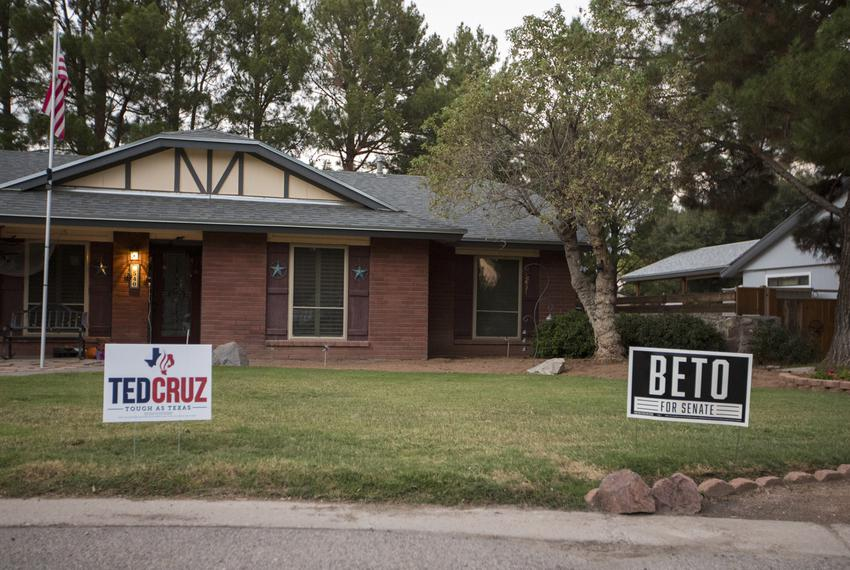Pro-Beto O'Rourke and pro-Ted Cruz signs in the front yard of the same home in an upper valley neighborhood of El Paso, Sund…