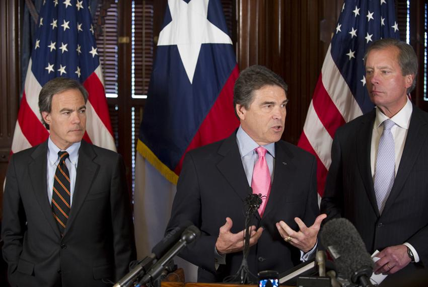 House Speaker Joe Straus, left, Gov. Rick Perry and Lt. Gov. David Dewhurst at a post-session press conference on May 31, ...