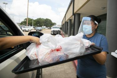 Maxula Velazquez Diaz distributes breakfast and lunch to a Katy ISD family at Sundown Elementary in Katy.