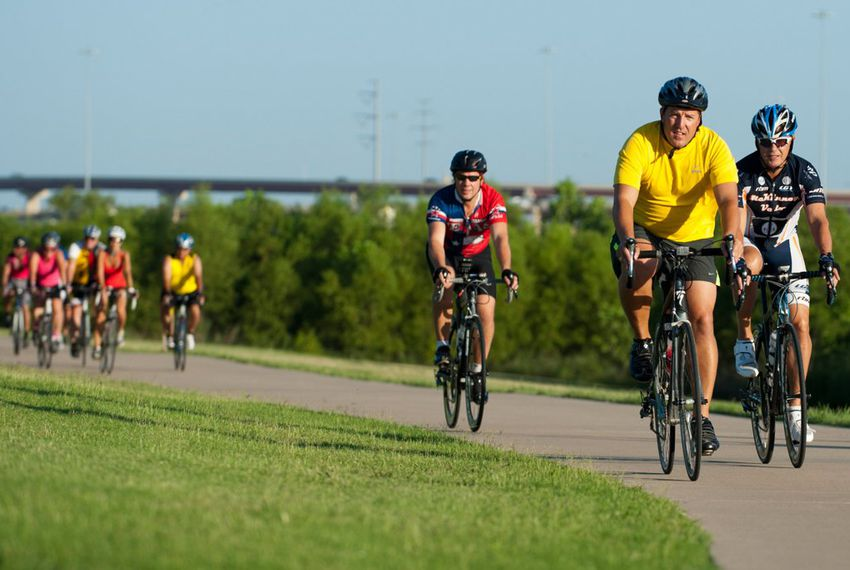 Mayor Pro Tem Stephen Lindsey of Mansfield (yellow) leads the pack during the first Elected Officials Bike Ride in Irving on Aug. 6, 2013, as part of the Transportation and Infrastructure Summit. Riders included nearly 15 mayors and council members from around North Texas with the common goal of promoting biking in their neighborhoods.