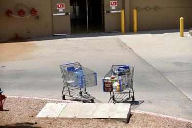Abandoned shopping carts outside of the WalMart where a mass shooting took place in El Paso on Saturday, August 3, 2019.