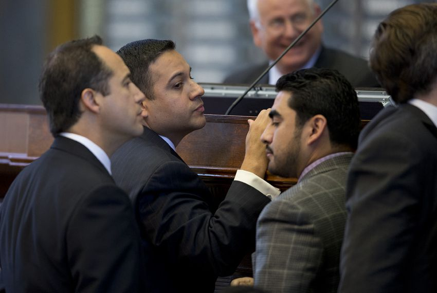 State Rep. Jason Villalba, R-Dallas, looks at Rep. Armando Walle, D-Houston, after Walle raised a point of order on HB 1009 on May 4, 2013.  The bill creating a school marshal program later passed to third reading.