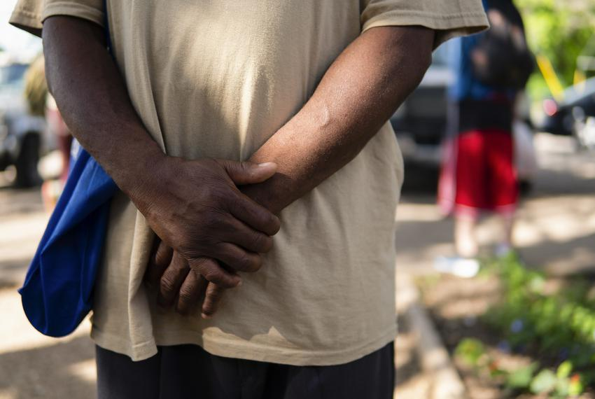Luke White stands in line at Sunrise Community Church's Homeless Navigation Center in South Austin on July 2, 2021.