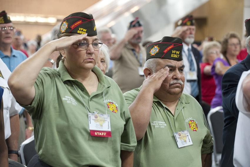 Veterans salute during the Pledge of Allegiance at the 112th annual VFW Convention in San Antonio on August 29, 2011.