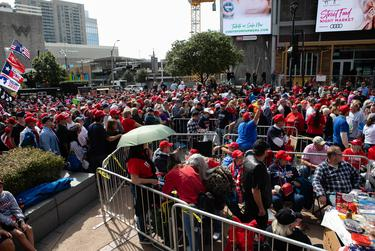 Supporters of President Donald Trump showed up in large numbers to the American Airlines Center in Dallas on Thursday, a few even camped out in line the night before and many stood in lines that continued for blocks around the arena.
