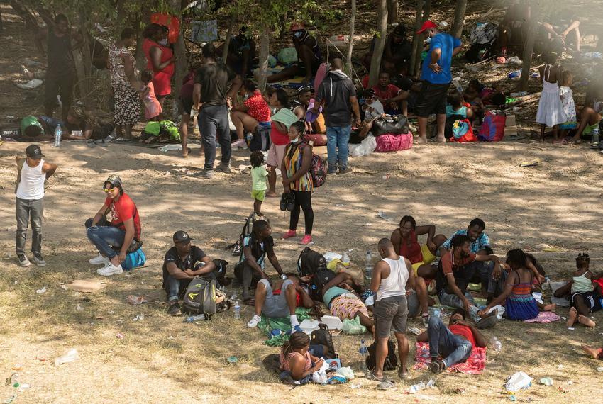 Asylum-seeking migrants rest under the International Bridge in Del Rio between Mexico and the U.S. on Sept. 15, 2021.