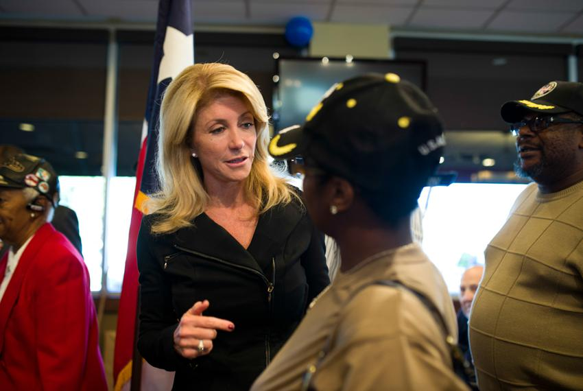 State Senator Wendy Davis speaks with Carnisha Campbell, an Army veteran, at Luby's in Forrest Hill during their Veterans Da…