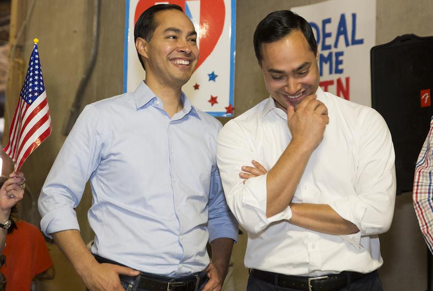 HUD Secretary Julián Castro, left, and his twin brother, U.S. Rep. Joaquin Castro, D-San Antonio, attend a Day of Action on …