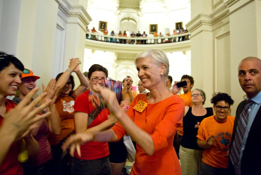 Cecile Richards talks with activists at the Capitol during the vote on HB2.
