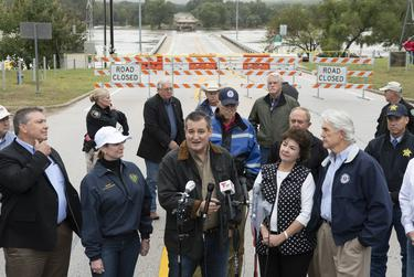 U.S. Sen Ted Cruz speaks as he views a washed out highway bridge during a tour of the Texas Hill Country on Oct. 17, 2018.