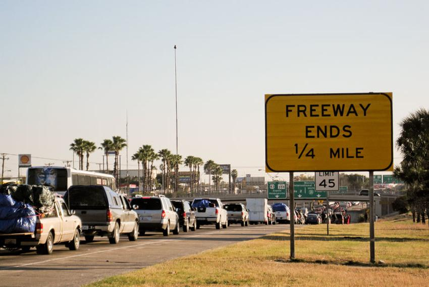 Thousands of motorists wait in line on the southernmost stretch of IH-35 in Laredo, Texas. Despite a global recession and es…