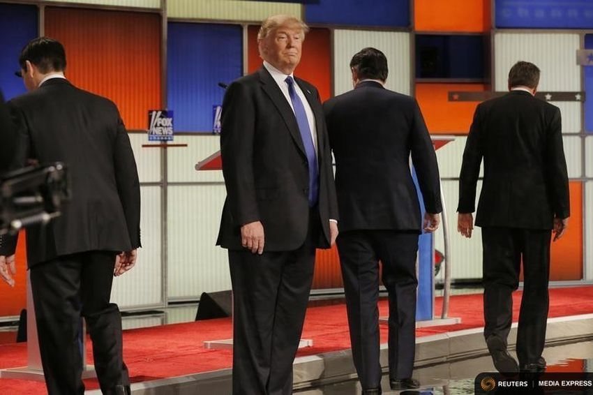 Donald Trump faces forward as other presidential candidates head to their debate podiums in Detroit, Michigan on March 3, 2016.