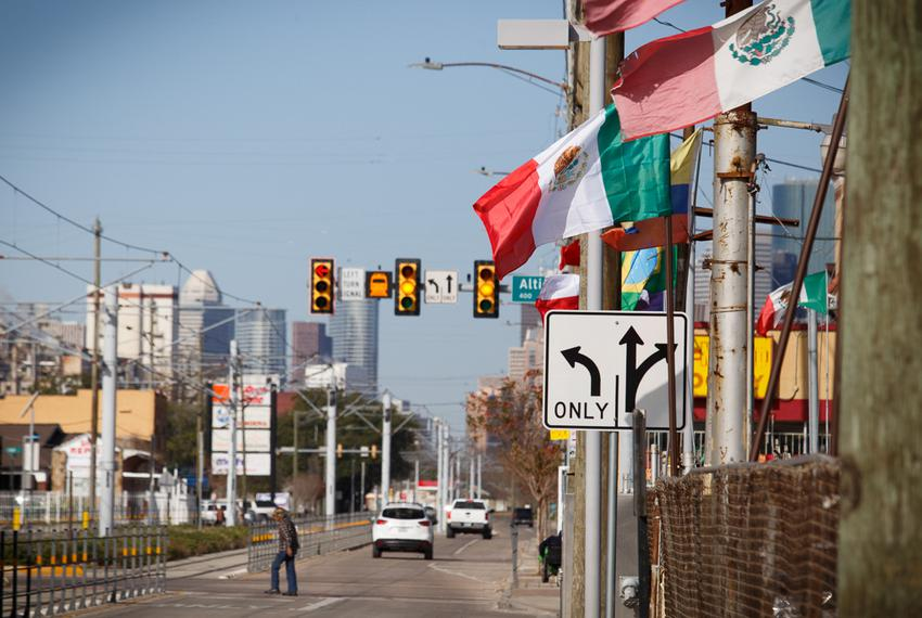 Mexican flags wave along Harrisburg Ave. in Houston. Drawn in 1991 to reflect the area's booming Hispanic population, the ...
