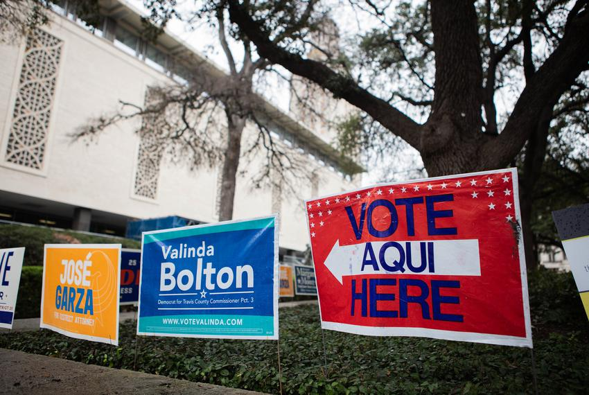 Voting signs at The University of Texas at Austin campus on Feb. 19, 2020, the second day of early voting for the Texas Pria…