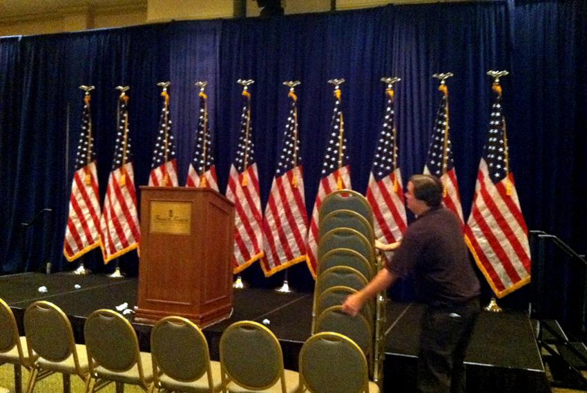 Guilds Davis installs chairs in ballroom at the Francis Marion Hotel in Charleston, S.C., on Friday, Aug. 12, 2011, where Go…