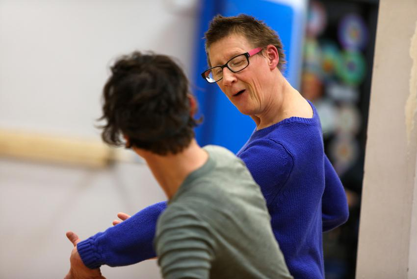 Susie Angel dances with Dany Casey during Body Shift Collective's dance rehearsal at Townlake YMCA in Austin, Texas on Feb...